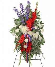 SALUTE TO A SERVICE MEMBER Standing Spray in Carman, MB | CARMAN FLORISTS & GIFT BOUTIQUE