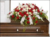 GRACEFUL RED & WHITE CASKET SPRAY  Funeral Flowers in Burton, MI | BENTLEY FLORIST INC.