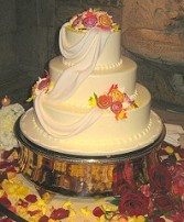 Wedding Cake Encircled with Roses & Petals in Oakdale, MN | CENTURY FLORAL & GIFTS