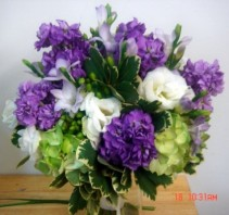 Purple, white and greens fresh flowers in a vase