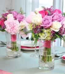 bridesmaid's bouquets/ doubled as  table arrang. roses/carns. and wild flowers