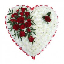 condolences from heart red roses and white pom pom saped heart standing spray
