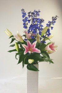 Delphinium Tall and luxurious  Style Fragrant lilies and delphinium in a 12 in  vase.