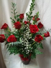 DOZEN RED ROSES ARRANGED IN A VASE WITH  Baby's Breath