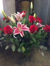 Long-stemmed red roses with stargazer lilies