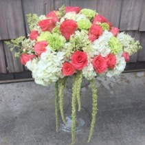 Exquisite Floral White hydrangeas, Coral roses, Green Carnations and Amaranthus and a tall clear vase