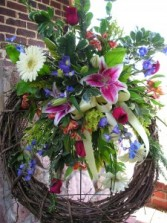Grapevine wreath with fresh flowers funeral flowers