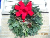 Holiday Wreath Mixed evergreens with pinecones and bow in Grand Island, NY | Flower A Day