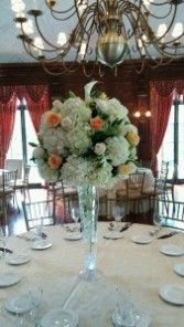 Hydrangea,white and peach roses,calla lilies Tall centerpiece