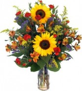 THOUGHTS AND PRAYERS TRIBUTE Mixed seasonal flowers in a vase.