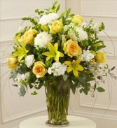 Yellow and White sympathy flowers arranged in a vase.