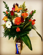 Just Because 12 Assorted Colored Roses, Mixed Flowers, with a Sweet Chocolate Treat!