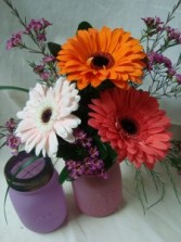 BRIGHT TRIO OF GERBERA DAISIES ARRANGED   WITH FILLER IN A CUTE MASON JAR! SALE!!!!!