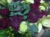 129 Burgundy and Plum assortment.  Hand tied and delivered without a vase.