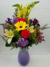 Make Me Smile Bouquet Brightly Colored Spring Arrangement in a Purple Vase