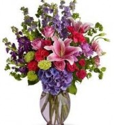 BS 1-Mixed flower arrangement in a tall vase (Flowers and colors may vary)