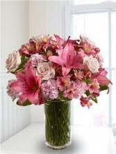 A 10-Mixed Flowers in a tall vase  (Flowers and colors may vary)