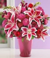 A 4-Mixed Flowers in a tall vase  (Flowers and Colors may vary)