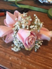 pink corsage of roses