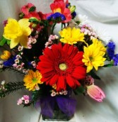 Bright spring flowers arranged in a rectangular  vase!