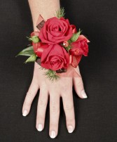 PUTTING ON THE RITZ RED Prom Corsage in Manchester, NH | CRYSTAL ORCHID FLORIST