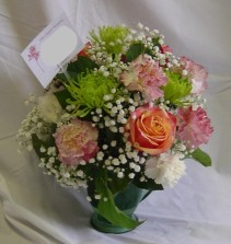 Roses and Carnations I use only the freshest flowers.  Combination of colorful Prima Roses and carnations