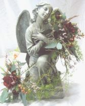 STATUE + FLOWERS We have a large selection of statuary for indoors and outdoors (in season). Allow us to decorate your choice with complimenting flowers and greens. Call for our current selection and pricing. in Mankato, MN | DRUMMERS GARDEN CENTER & FLORAL