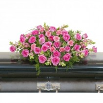TEARS OF SORROW Half Casket Spray of pink roses and carnations, pink snapdragons and more.