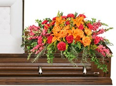 TRIUMPHANT TRIBUTE Casket Spray in Conroe, TX | FLOWERS TEXAS STYLE