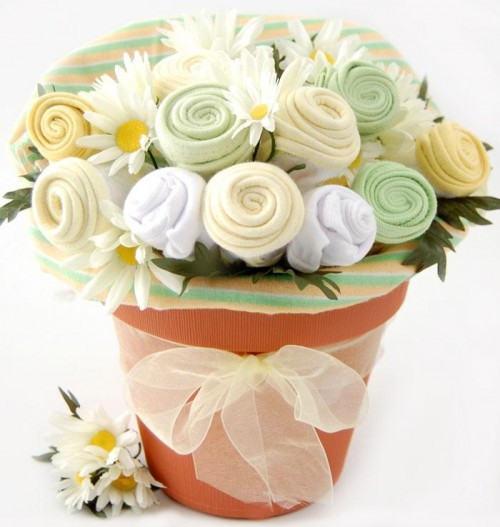 New baby flowers from posh floral designs incwecome baby flowers beautiful flower centerpieces add to the decor of any baby showerevery new mom needs a corsage for the event customized new baby gift baskets or balloon negle Choice Image